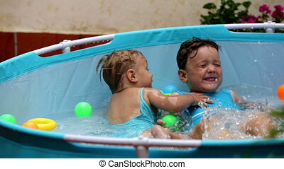 Happy children swimming  in  po