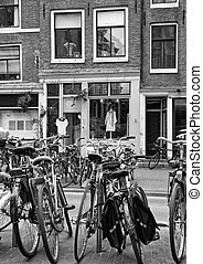 Bicycles in Amsterdam Netherlands - BW photo of weaned...
