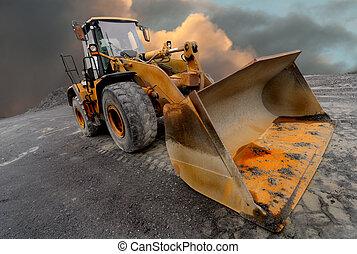 Loader excavator - Image of a quarry Loader excavator with a...