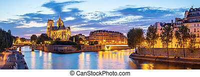 Notre Dame Cathedral with Paris cityscape panorama at dusk,...