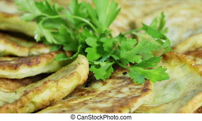 Pancakes on plate - Rotating fritters decorated with parsley