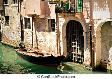 Canals of Venice. Italy - Boat next to a door. Canals of...