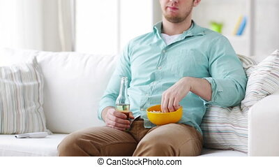 man with popcorn and beer changing tv channels - food,...