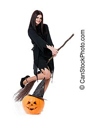Flying witch - Young sexy witch flying on a broom isolated...