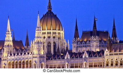 Parliament building in Budapest at night. The camera moves...