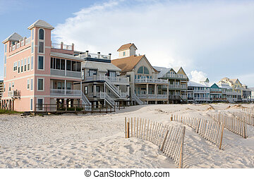 Luxury Beach Homes - A row of luxury beach homes line the...