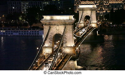 Night traffic of cars on Secheni Bridge through Danube in...