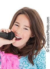 Caucasian Kids - Caucasian children singing karaoke on a...