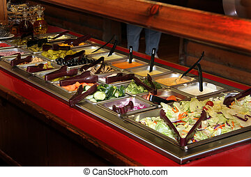 Salad Bar - A restaurant salad bar is filled with fresh...