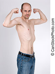 Skinny Man - A skinny man tries to pump up his muscles