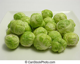 Brussels sprouts arranged on a white plate