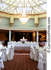 Wedding Reception Hall - A chandelier hangs over the dance...
