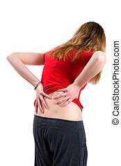 Woman With Back Pain - A young woman bends over with back...