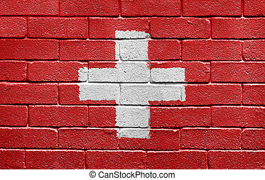 Flag of Switzerland on a brick wall