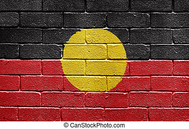 Flag of Aborigines on brick wall