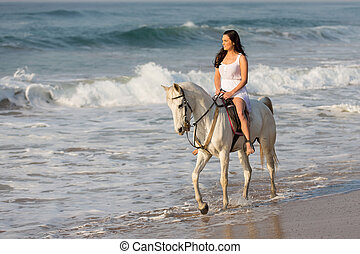 young lady riding horse on beach - pretty young lady riding...