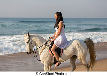 girl in white dress riding a horse on beach - gorgeous girl...