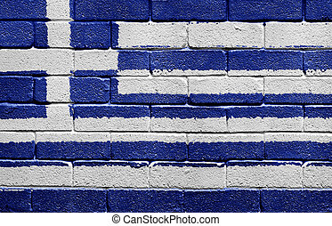 Flag of Greece on a brick wall