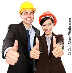 two standing workers showing thumbs up. managers and foreman...