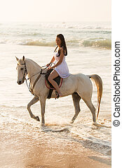 happy young lady horse ride on beach - happy young lady...