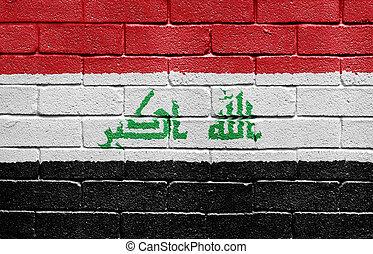 Flag of Iraq on brick wall
