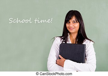 school teacher in front of her blackboard