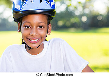 young indian girl with bicycle helmet