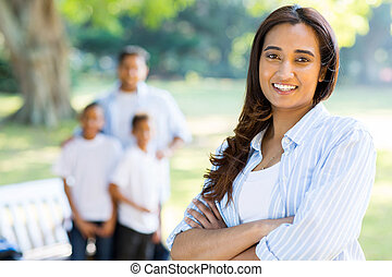 indian woman standing in front of family