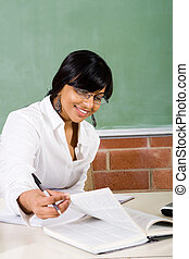 working woman - a teacher working hard planning lessons