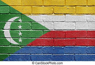 Flag of Comoros on brick wall