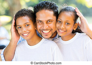 happy indian father and kids closeup portrait outdoors