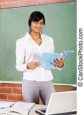 teacher with book in classroom
