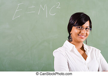 maths teacher - lovely indian maths teacher posing in...