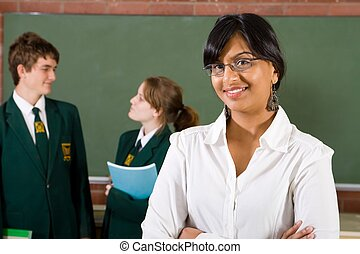 lovely teacher - teacher with talking pupils behind her