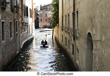 Man on a boat in Venice