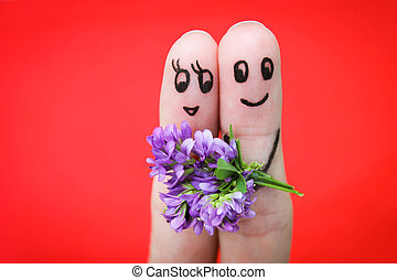 Man is giving flowers to a woman. - Happy couple. Man is...