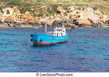 blue boat at port of city Mgarr Malta - Old blue boat at...