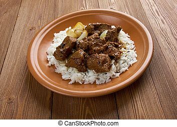 Moroccan Lamb Tagine - Moroccan Tagine with tender lamb and...