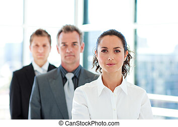 Serious businesswoman in front of her team - Serious young...