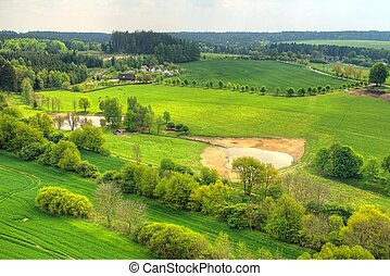 Green landscape - Photo shows green landscape with trees and...