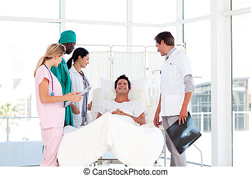 Consultation between a surgeon and a patient - Medical...