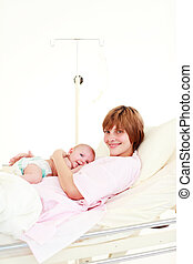 Patient with newborn baby in bed with copy-space - Patient...