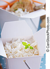 Cooked rice in a take away box - Cooked, plain rice in a...
