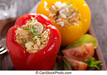 Vegan stuffed peppers with rice, mushrooms and vegetables