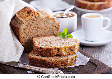 Banana bread on a cutting board - Banana bread sliced on a...