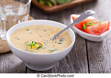 Vegetables and corn chowder in a bowl