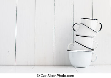 five white enameled mugs - A stack of five white enameled...