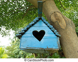 wooden birdhouse - Blue wooden birdhouse hanging on the...