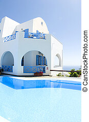 cyclades greek island architecture with swimming pool -...
