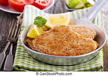 Pork schnitzel with parmesan - Pork schnitzel with lemon...